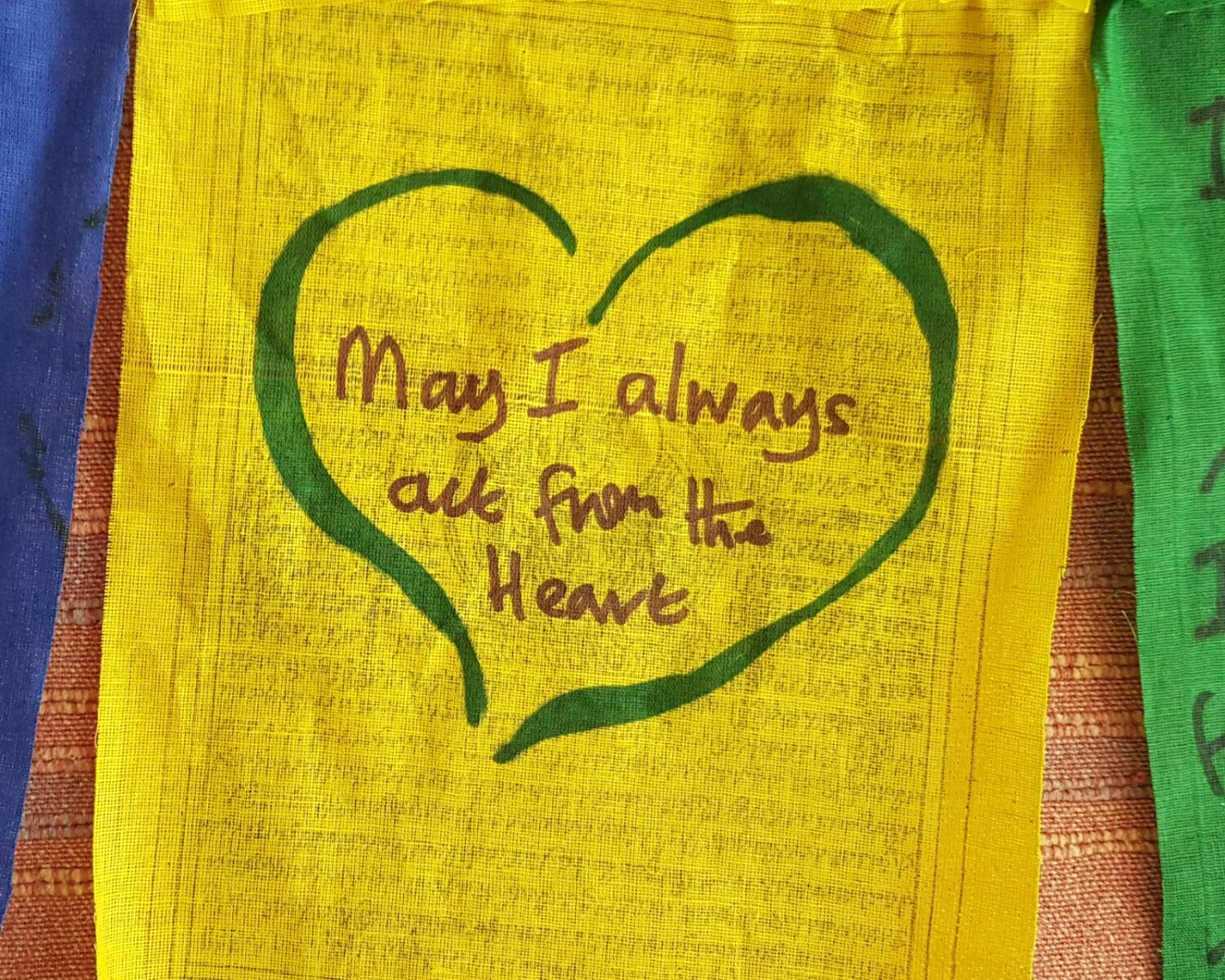 "Heart with the words ""May I always act from the Heart"" written inside."