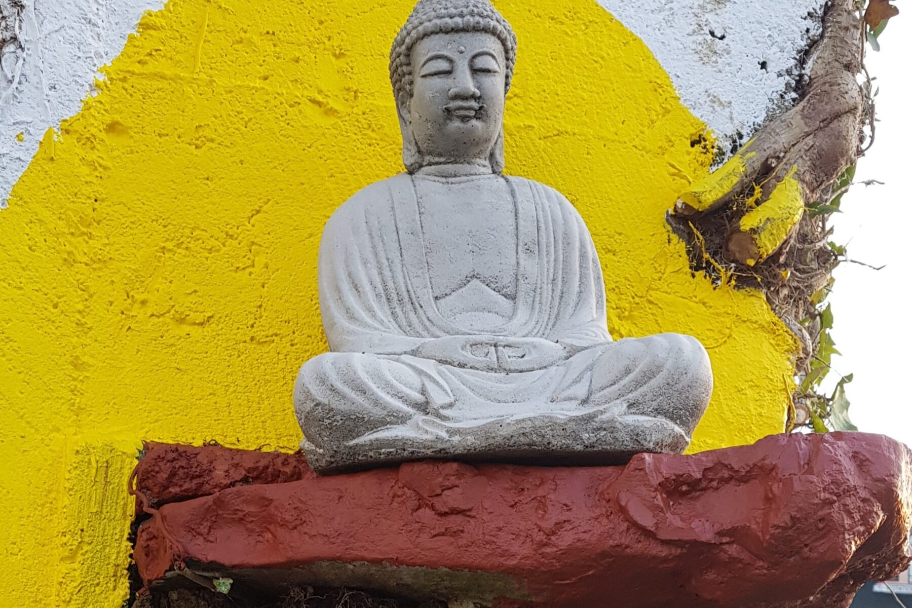 Buddha Statue sitting on a ledge at Nalagiri House