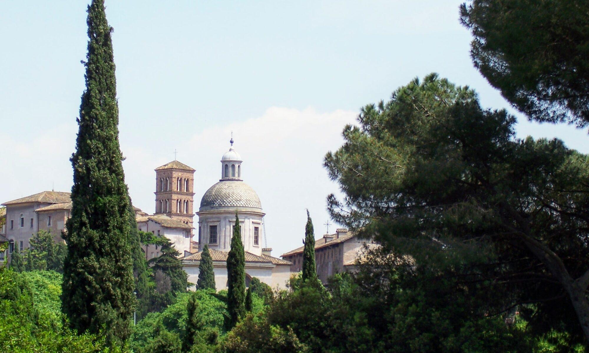 Roman buildings viewed above treeline.