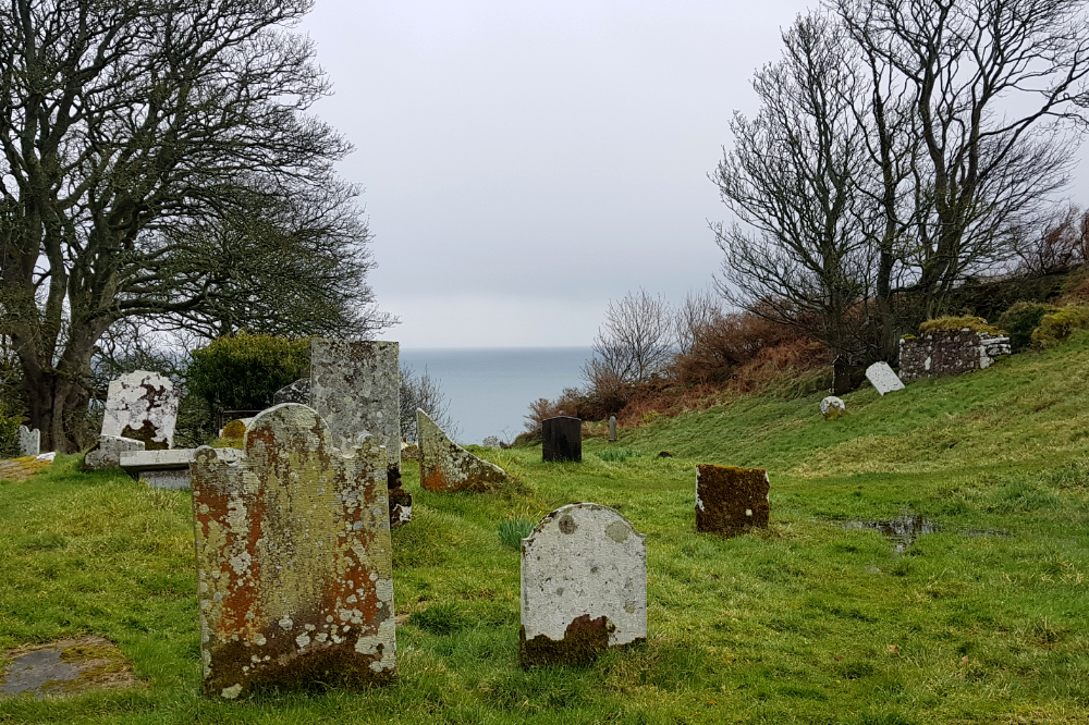 Ancient gravestones overlooking the sea.