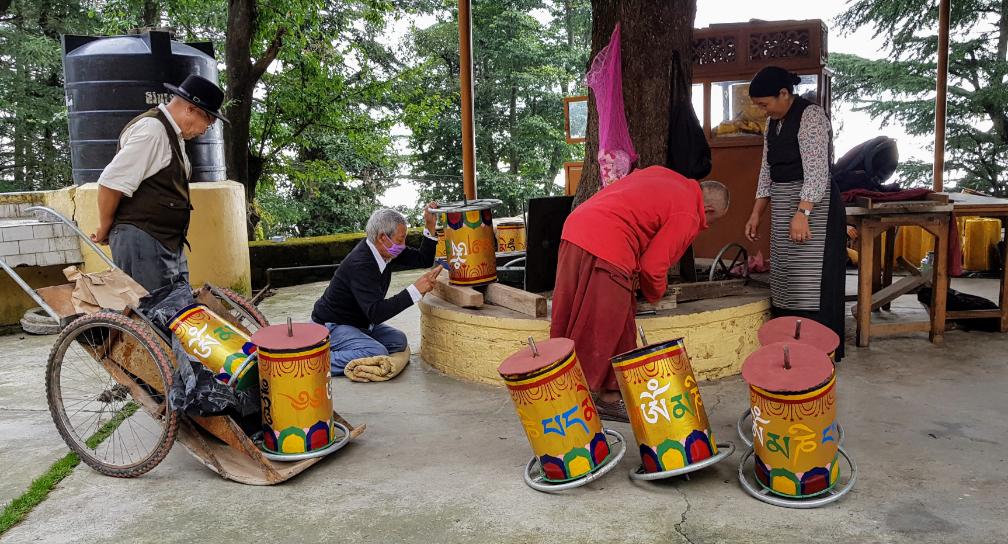 Tibetan monk painting Prayer Wheels in Dharamsala.
