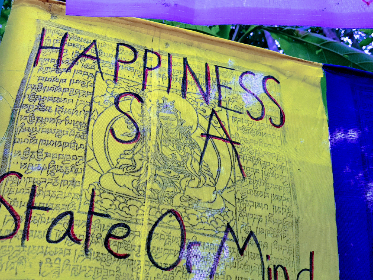 """Happiness Is A State of Mind"" handwritten on a Tibetan Prayer Flag"