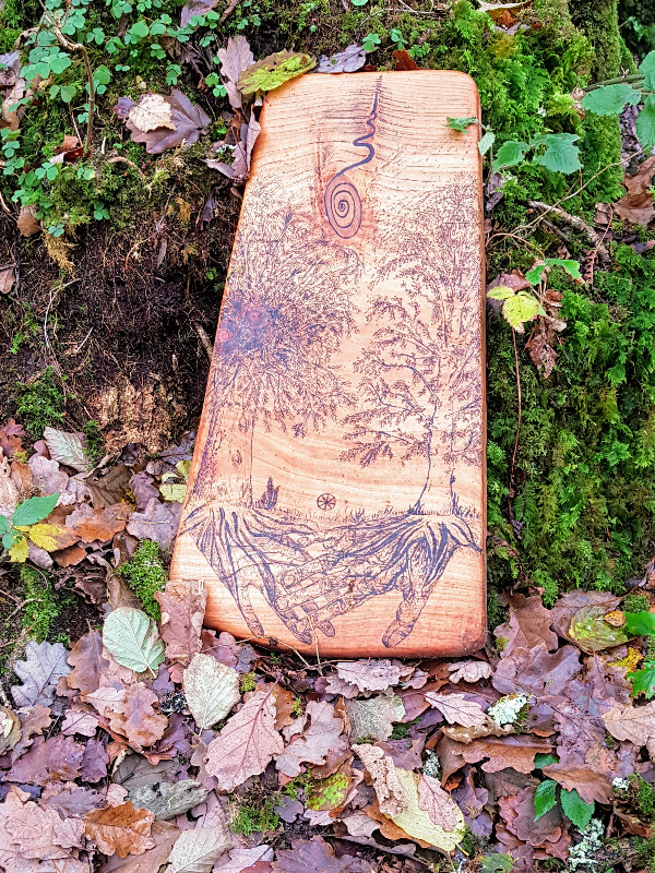 Wood carving in woodland at Sunyata Buddhist Centre, County Clare, Ireland