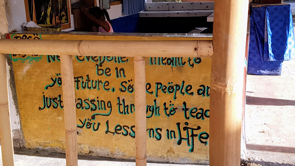 Handwritten sign 'Not everyone is meant to be In your future, some people are just passing through to teach you lessons in Life'
