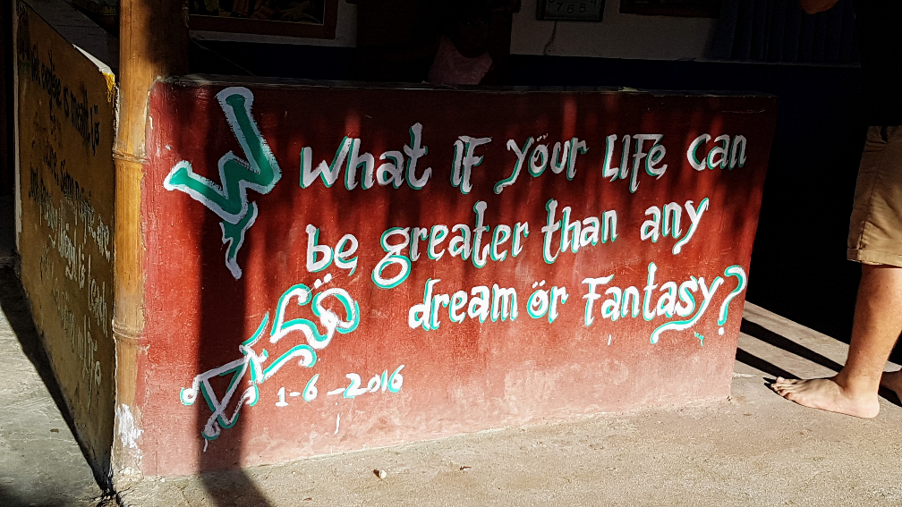 """Hand painted sign that reads """"What if your life can be greater than any dream or Fantasy?"""""""