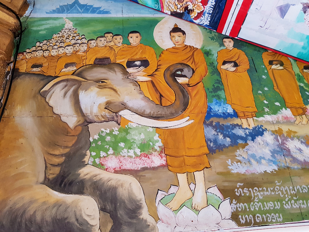 Image of Buddha calming a prostrated elephant