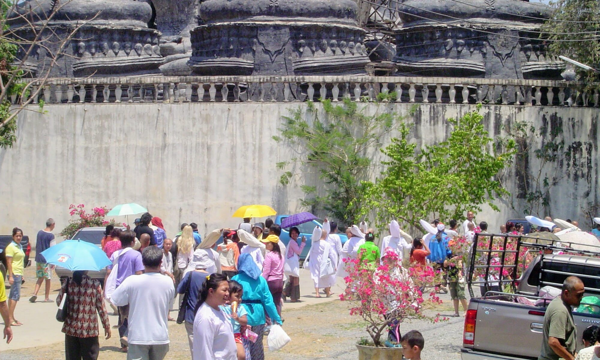 Crowd of Buddhist nuns and laypeople with children setting of on Tudong (walking pilgrimage)