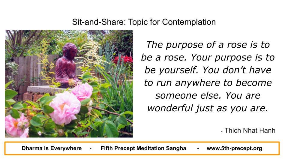 Buddha statue amongst Roses