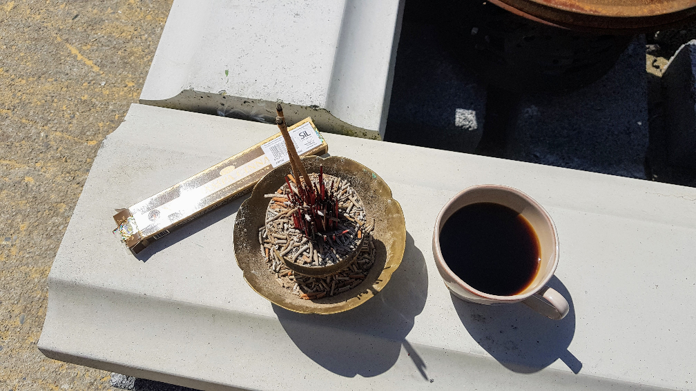 Burning incense and cup of coffee