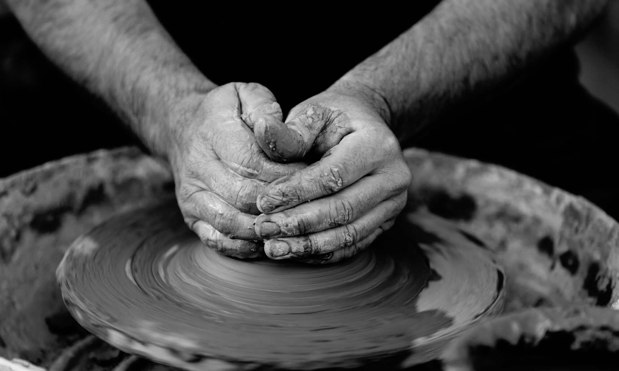Hands and clay on potters wheel